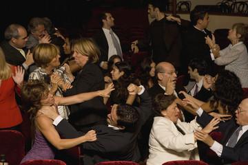 Hispanic people fighting in theatre