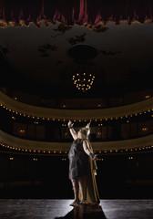 Female opera singer singing on stage