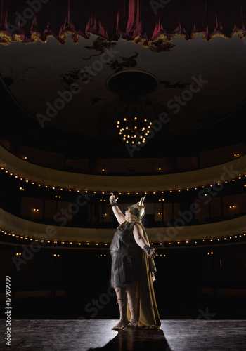 Female opera singer singing on stage