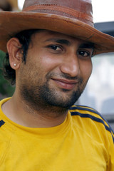 Smiling Indian man with a cowboy hat