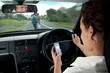 Leinwanddruck Bild - The Dangers of Texting While Driving