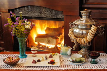 tea drinking at a fireplace