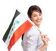Lovely young woman with an Iraqi flag against white background