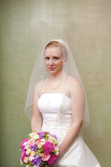 Bride with Bouquet Looking at Camera