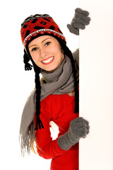 Woman in winter clothing holding a billboard