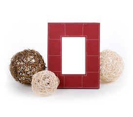 stylish red leather photo frame with some clews laying by it