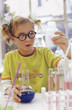 Girl (8-9) in chemical lab, close-up