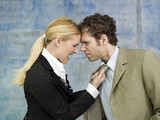 Businessman and businesswoman quarrelling