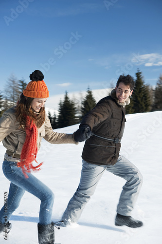 Couple running in winter scene