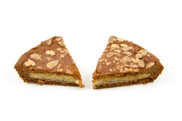 slices of typical Dutch pie with almond over white background