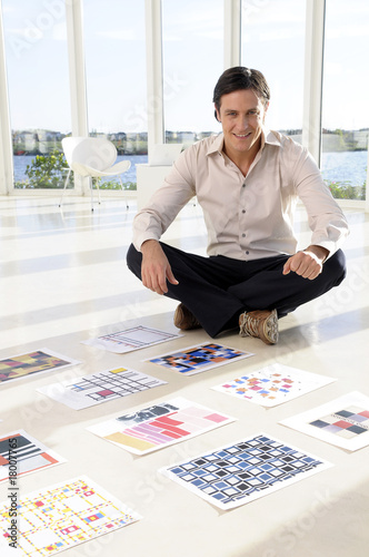 poster of Creative sitting on the floor