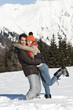 Couple embracing in winter scene