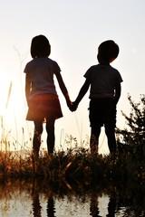 Two children, sunset, romantic scene