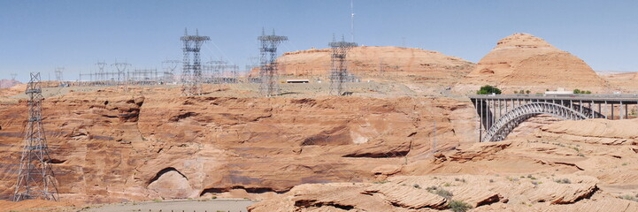 Electrical tower on a background of arid stones