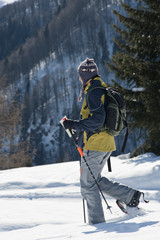 Young man in snow hiking