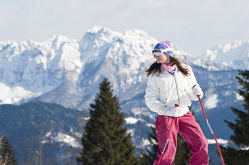 Young woman in snow skiing