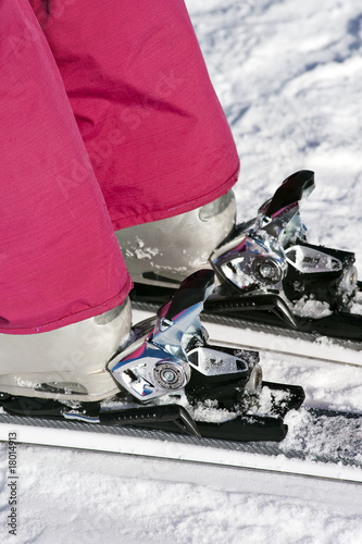 Closeup of boots in ski binding