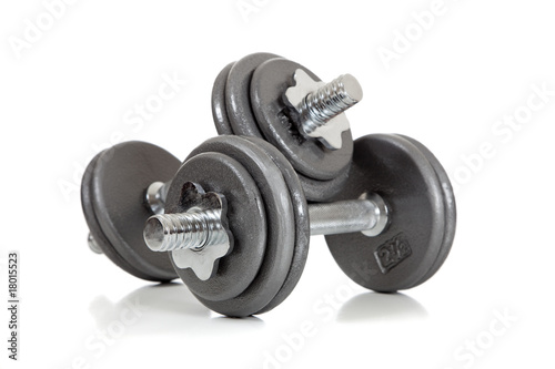 Leinwanddruck Bild set of dumbells on white