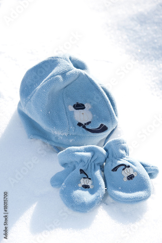 Baby mittens and hat in snow