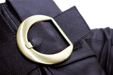 Golden buckle of leather brown boot