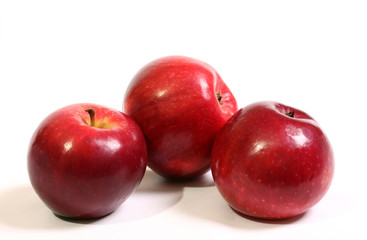 Juicy, ripe, red apples on a white background.