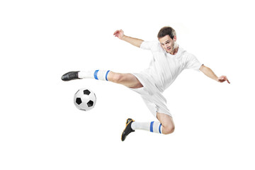 Soccer player with a ball in action isolated on white