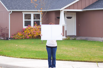 Holding White Sign