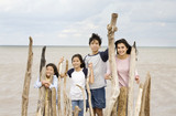 Four siblings by the lakeshore in summer poster