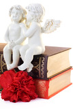 Figurine of two angels sitting on the book
