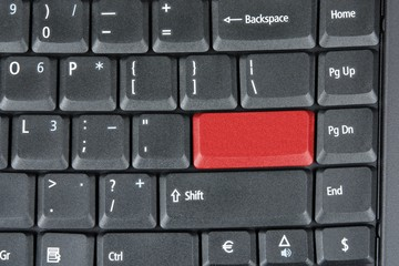 Computer keyboard with red key, technology background.