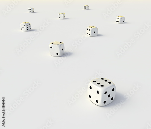 Abstract playing dice on a flat white surface.