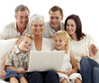 Happy family using a laptop in living-room