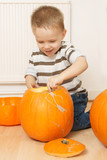 happy little boy with pumpkin