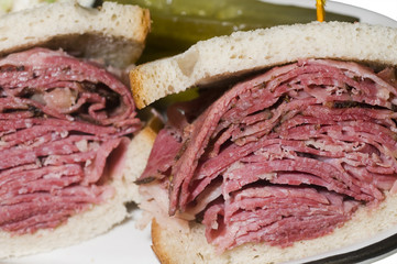 corned beef pastrami combination sandwich rye bread pickles