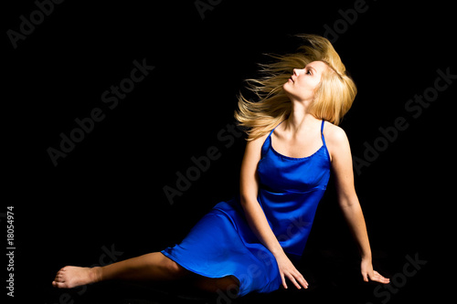 young blondie girl with spreading hair in the studio