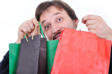 Young man with bags for shopping