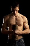 Sexy Muscular Man with Dumbell