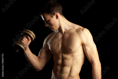 Sexy Muscular Man with Dumbells
