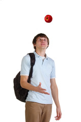 Young student throw up red apple