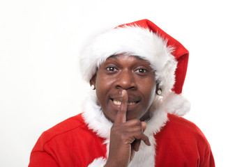 black santa claus telling to keep it quiet