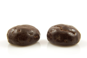 Two chocolate ginger nuts in closeup over white background