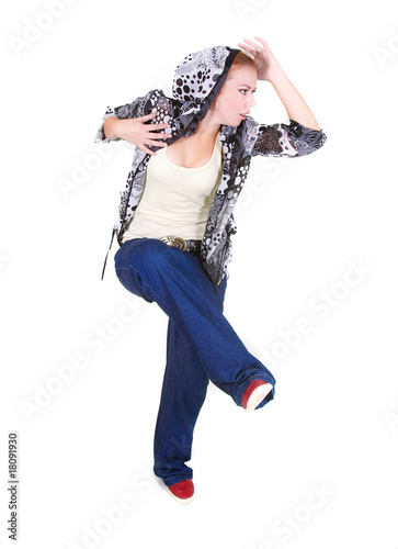 attractive girl dancing hip hop over white