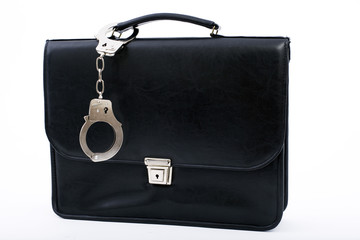 pinned to closed black bag from metal fastening handcuffs
