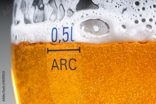 Glass of the beer with foam