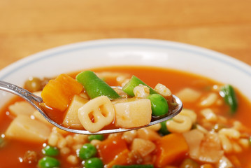 spoon full of vegetable soup