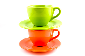 Stack of orange and green coffee cup