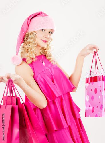 Фото со стока - веселый Санта помощник с розовой хозяйственные сумки.