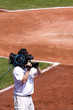 Cameraman on Baseball Field