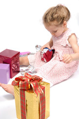 Girl opening Christmas presents