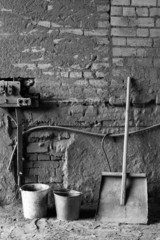Black-and-white composition with buckets and a shovel